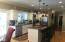 Large kitchen with gas Jennair burners and grill. Stainless steel appliances and granite counter tops. Double ovens and convection microwave