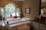 Master bathroom has jacuzzi jetted tub and separate shower