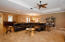 Large open living room with trayed ceilings