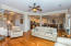 Open living/kitchen/dining areas lead out to a wonderful screened-in porch overlooking the lake w views galore
