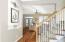 Home features designer lighting, granite counters and wood floors