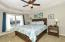 Lakeside master with ensuite bath and walk-in closet. Water views are wonderful from almost every bedroom