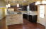 stainless steel appliances/granite counters/backsplash tile