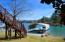 Covered boat house offers two spaces for lake toys.