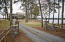 "What an estate! Nothing says ""welcome to Lake Martin"" like a split-rail fence and a pea gravel circular driveway"