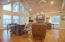 This vaulted living room was added in 2001/2002. Recessed lights, wooden ceiling, stone fireplace, and wall-of-windows