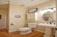 Hall bath with stand alone shower.