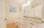 Full hall bath. Granite countertops, built-in drawers & tub/shower combo