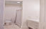 Full bath in the hall, across from the 2 guest bedrooms.