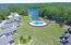 Rear green area, pool, boardwalk/piers