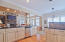 Black granite countertops, a double-height breakfast bar, French-style custom cabinetry...