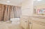Tub/Shower combo, granite countertop, tile flooring.