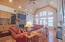 Wooden Barrel ceilings in the living room, stack stone fireplace, pine floors, built-in shelving, security system with interior and exterior cameras