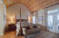 The Master suite: Where entertaining meets weekend respite. Wooden barrel ceiling, hardwoods, access to the gorgeous partially-covered private deck