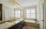 Separate shower & soaking tub, his/her vanities