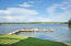 Want to enjoy a large dock space now, while you dream of your covered boathouse? You can here