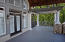 Grand entrance from the living room to the covered dock. Wooden beams, vaulted ceiling...