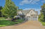 Immaculate grounds -- in-laid stonework sets off the plush grass from roadside to waterfront.
