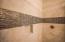 Custom tile work in master shower