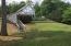 Just a few stairs or easy golf cart ride to large flat yard at water's edge