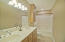 "This hall bath is for the ""back"" three bedrooms...added on in the mid-2000s."