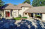 Beautiful courtyard entry with 2 car carport and garage attached to the home