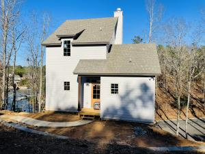 """picture of a completed """"ramp house"""" on Lot 2. Shown to be an example of what will be built on Lot 5."""