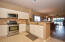 Updated kitchen features stainless steel appliances, granite counters, tumbled marble backsplash and a top of the line refrigerator