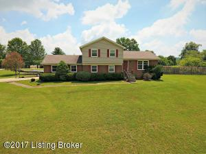 This charming home features a brick exterior with red shutters and a large front yard, decorative iron railing lining the front steps, and fenced in backyard with wood deck and inground pool; a great space for entertaining!