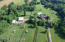 Another aerial view of house, barn, paddocks.