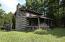 Original log cabin is in back of yard--full of fun antiques!