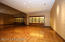 Dining room has same hardwood flooring and is very large.
