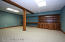 Large lower level finished room for hobbies, private office, library or media room.