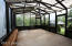 Greenhouse is attached to the home and may be accessed through the master bath or from the yard.