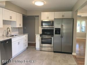 Totally remodeled kitchen with tile floor and granite countertops