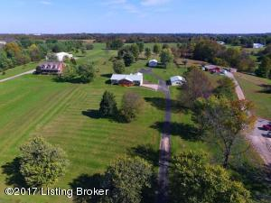 5 acres with ranch home and 2 outbuildings