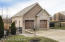 Detached 4 car garage is all brick & stone exterior.