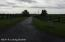 A paved entry road and Black Board Farm Fencing say this is Kentucky at its Best!