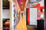 Condo hallway with hardwood floors