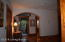 Upstairs hall, nice architectural arch leading to hall bath and snack/guest area