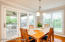 Large windows allow you to overlook your yard while dining.