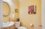 Half bathroom located right off first floor main living spaces.