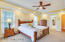 The owners suite bedroom is spacious in size and well lit by the large windows and tray ceiling with recessed lighting.