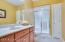 The full bathroom in the lower level provides privacy when hosting guests. Enjoy a walk-in shower an a large vanity.