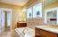 Master bathroom with jetted tub, separate shower, granite counters and water closet