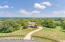 The property is surrounded with gorgeous 4 board fence and lush landscape.