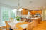 The kitchen is spacious and updated.