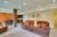 Recessed lighting and an open concept floor plan allow room to easily entertain large crowds.