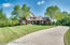 The long sweeping driveway leads you back to this gorgeous home set away from the road on 5 private acres.