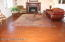Large Living Room filled with Southern Charm. Original Mantle with wood stove fireplace. Fantastic Hard wood flooring throughout the main floor.